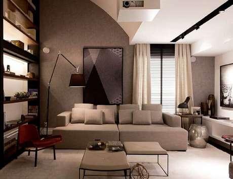 38. Os quadros grandes para sala de estar decorada em tons neutros traz mais charme ao ambiente