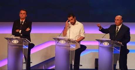 Os candidatos Jair Bolsonaro (PSL), Guilherme Boulos (Psol) e Henrique Meirelles (MDB) durante o debate