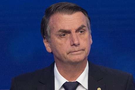 O candidato à Presidência da República pelo PSL, Jair Bolsonaro, participa do primeiro debate entre os presidenciáveis das eleições de 2018, promovido pela Rede Bandeirantes de Televisão, em São Paulo, na noite desta quinta-feira, 09.
