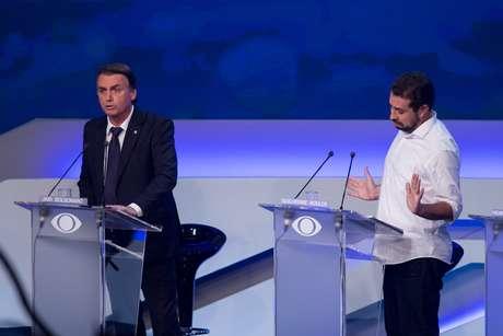 Jair Bolsonaro e Guilherme Boulos durante o debate da Band desta quinta-feira (9)