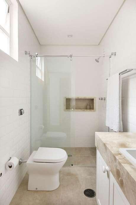 38. Para otimizar o espaço, utilize o nicho no box do banheiro