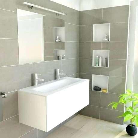 2. Decoração clean de banheiro com nicho embutido