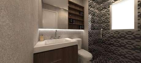 3. Iluminação indireta atrás do espelho deixam os banheiros modernos