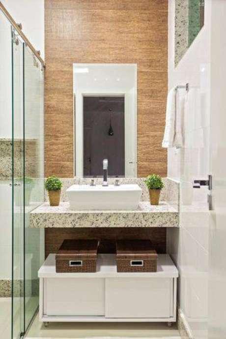 38. Mantenha seu banheiro organizado, use caixas e prateleiras