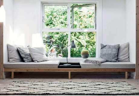 15. Cantinho da leitura com decoração minimalista – Foto: Boligmagasi