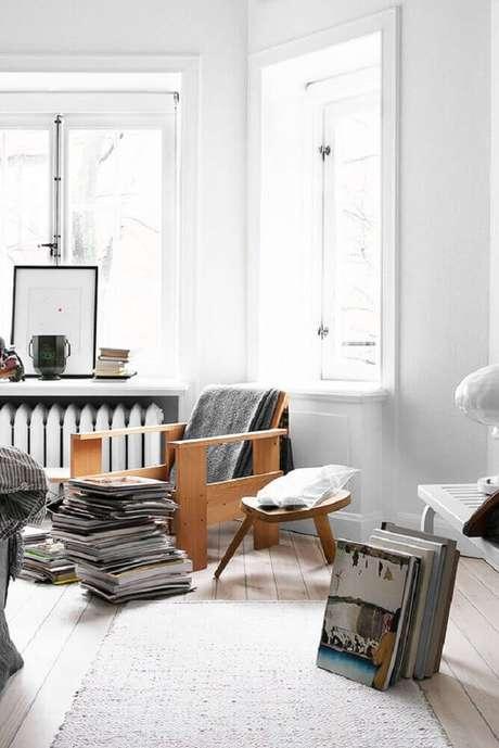 50. Decoração em tons neutros para cantinho da leitura minimalista – Foto: Tres Studio