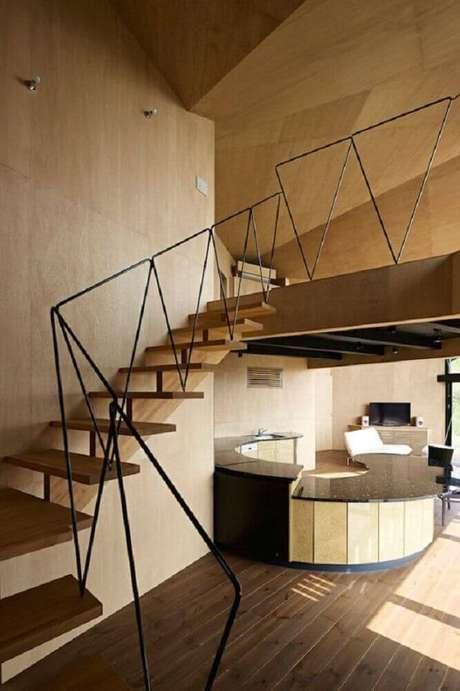 24. Design arrojado para guarda-corpo de ferro em escada de madeira – Foto: 90degree