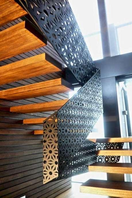 36. Escada de madeira com modelo diferente de guarda-corpo de alumínio com design arrojado – Foto: Futurist Architecture