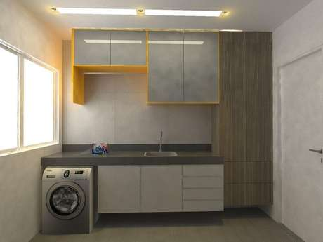 32. Decoração para lavanderia amarela e cinza com armário para área de serviço – Foto: Larissa Vinagre