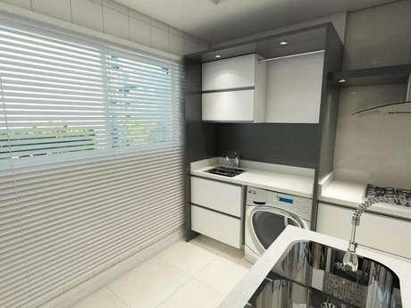 66. Lavanderia pequena integrada com cozinha moderna – Foto: Ednilson Hinckel