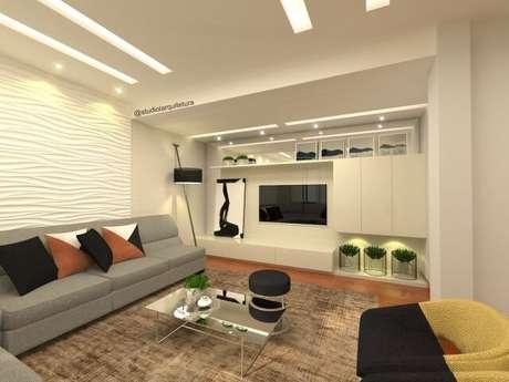 12. Sala de estar com parede de gesso 3D com textura de ondas. Projeto de Lais Rocha