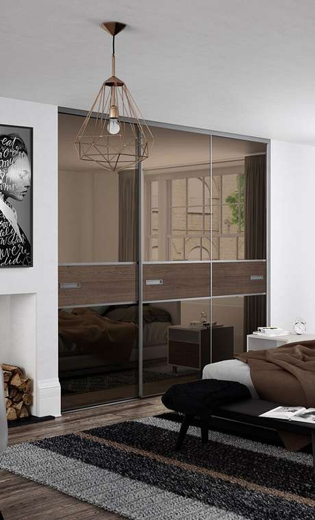 8. Modelo de guarda roupa espelho bronze – Foto: Homelicious
