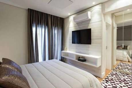 18- No painel para quarto foram embutidos à tv e o ar condicionado. Fonte: Casar É…