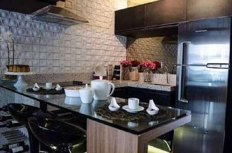 47- O Revestimento 3D branco para cozinha deixa o ambiente diferenciado e moderno. Fonte: Pinterest