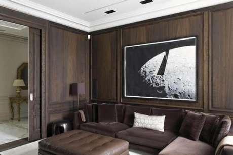 47. Decoração para sala com boiserie de madeira – Foto: Roberto Migotto