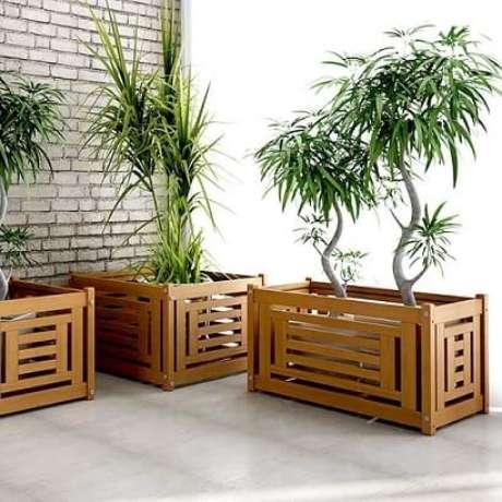 5. Um cachepot de madeira com recortes como esses tem um visual bem moderno. Foto de HF Urbanismo