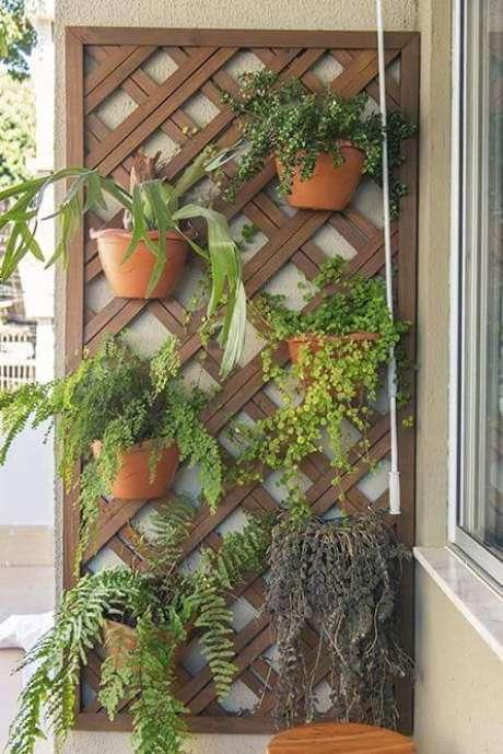 62. Jardim vertical em treliça de madeira. Projeto de Casa Aberta