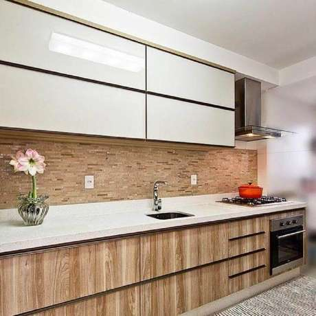 18. Modelo de armário de cozinha planejado em marcenaria – Foto: Mendonça Pinheiro Interiores