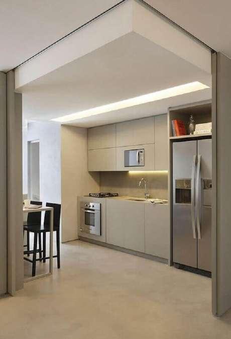 71. Decoração minimalista com armário planejado para cozinha pequena – Foto: Pinterest