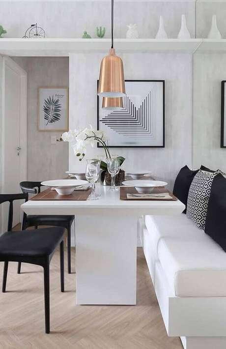 27. O pendente para sala de jantar moderna trás um charme super especial para a decoração do ambiente – Foto: The Holk
