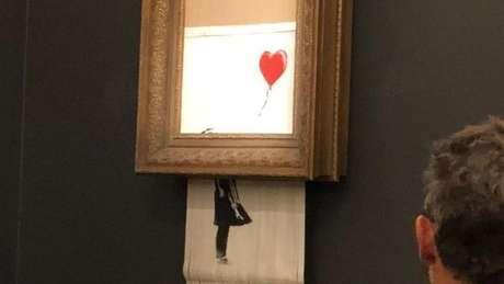 Minutos depois de o quadro Menina Com Balão ser vendido na casa de leilão Sotheby's, em Londres, a tela se autodestruiu.