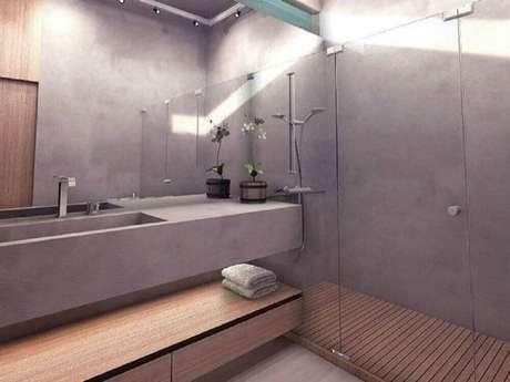 50. O cimento queimado é perfeito para compor a decoração de banheiro planejado moderno – Foto: Poligonus Arquitetura