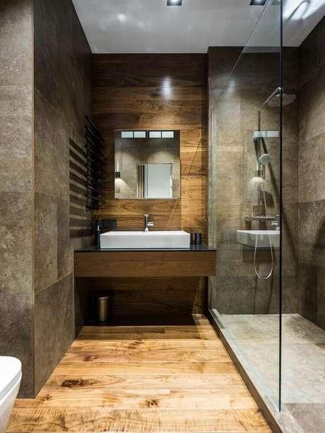 7. O toque em madeira no banheiro planejado moderno com acabamento que imita cimento queimado, deixa o espaço super aconchegante – Foto Pinterest
