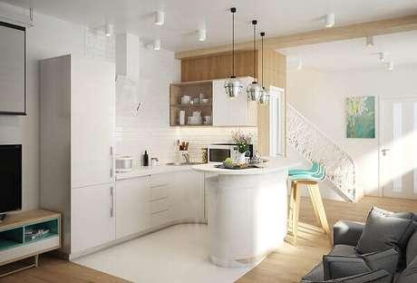 16- Na cozinha americana pequena com sala simples foram utilizadas as linhas modernas e curvas. Fonte: Pinterest