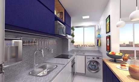 21- Na área da cozinha americana pequena foi instalada a máquina de lavar roupas. Fonte: Pinterest