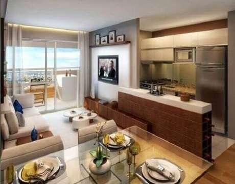 67- A cozinha americana pequena amplia o ambiente da sala e leva conforto ao ambiente. Fonte: Live Forum