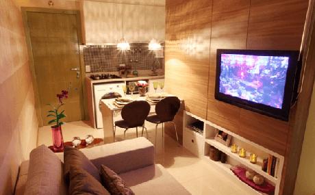 65- Na decoração do apartamento foram utilizados nichos na cozinha americana pequena com sala simples. Fonte: Decoração de Sala