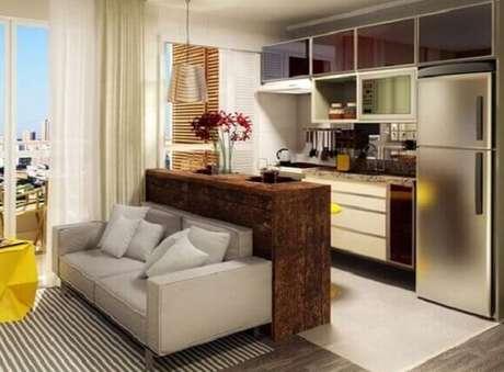8- Cozinha americana pequena com sala simples em apartamento tipo Studio. Fonte: Webcomunica