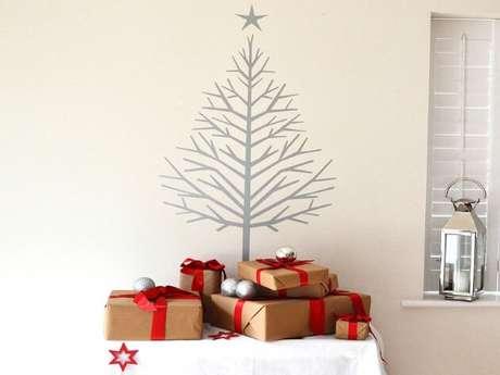 58. Árvore de natal feita de adesivo na parede. Foto de TLife