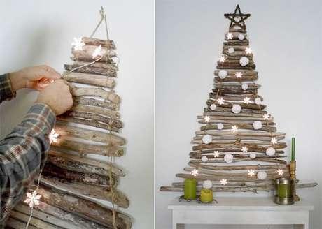 17. Galhos podem dar uma linda árvore de natal artesanal. Foto de Business and Cafe