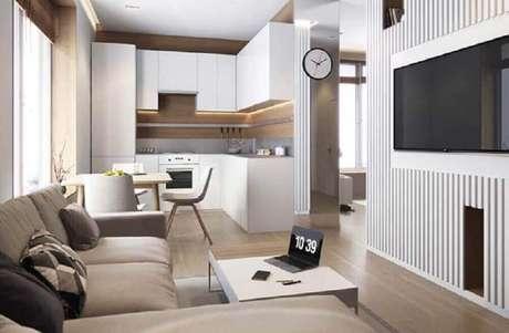 33. Decoração minimalista para cozinha integrada com sala de estar e de jantar – Foto: Pinterest