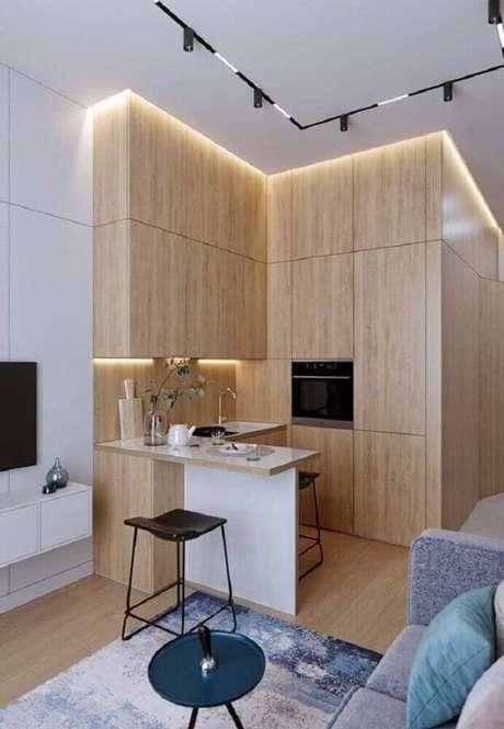 45. A cozinha integrada com sala ajuda a aumentar visualmente o ambiente – Foto: Aaron Guides