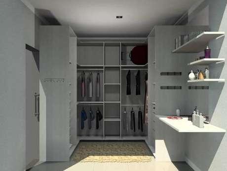 11. Closet composto por guarda-roupas planejados. Projeto de Karina Chavare