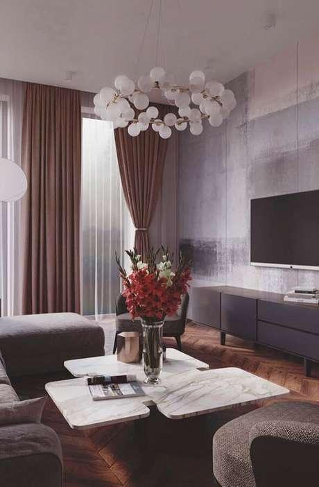 48. A sala de estar merece uma decoração especial, por isso, escolha luminárias de teto que se harmonizem e tragam mais beleza à decoração – Foto: Pinterest