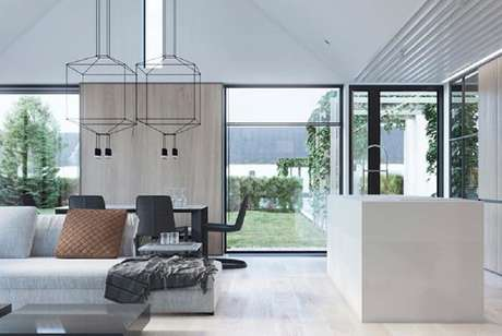 64. Luminárias de teto com design arrojado para decoração de sala de estar ampla integrada com cozinha e sala de jantar – Foto: Wisozk