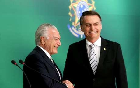 O ex-presidente da República, Michel Temer (MDB), e o presidente Jair Bolsonaro durante declaração conjunta no Palácio do Planalto, em Brasília