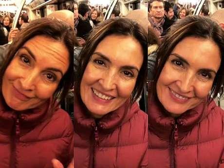 Fátima Bernardes sorria para o namorado enquanto ele a gravava no metrô lotado da capital francesa.