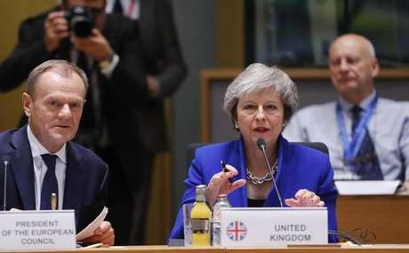 O presidente do Conselho Europeu, Donald Tusk, e a primeira-ministra do Reino Unido, Theresa May