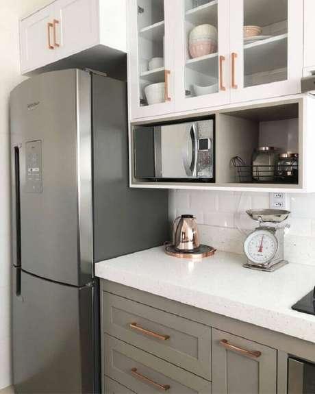43. Decoração clean para cozinha com detalhes em rose gold – Foto: Casa Apê