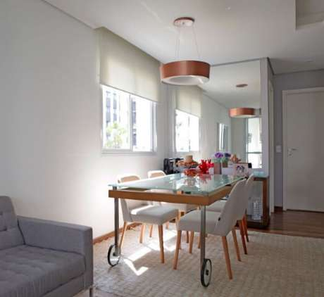 55. Tanto a sala de estar quanto a sala de jantar devem fazer parte da organização de casa. Projeto de Joanna Marino