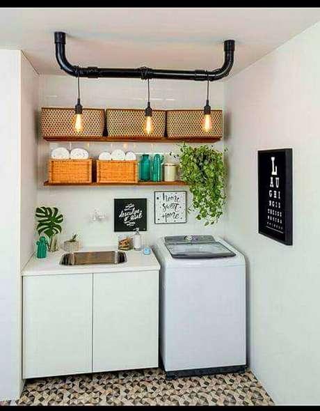 46. A lavanderia também pode receber caixas organizadoras para guardar produtos de limpeza – Foto: Quadrilha Design e Arquitetura
