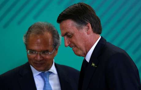 Brazil's President Jair Bolsonaro and Economy Minister Paulo Guedes attend a ceremony at the Planalto Palace in Brasilia, Brazil January 7, 2019. REUTERS/Adriano Machado