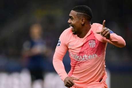Malcom pode ir jogar com Lucas no Tottenham (Foto: Marco Bertorello / AFP)