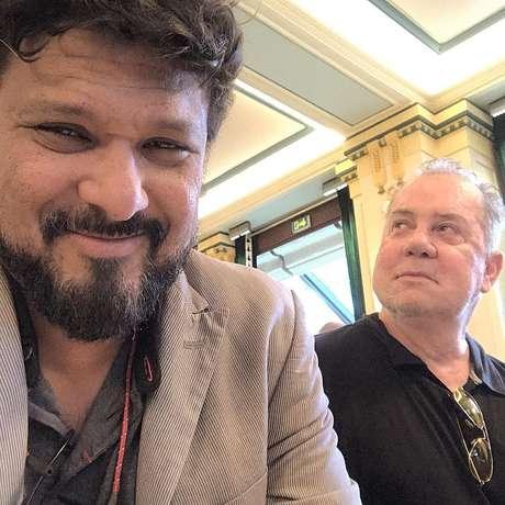 Luiz Fernando Guimarães (ao fundo) com Adriano Medeiros: parceria de muitos anos no amor e nos negócios