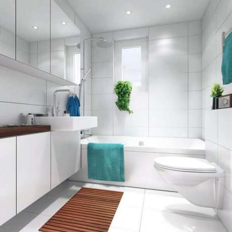 33- O tapete para banheiro de madeira combina com a bancada da cuba. Fonte: Hative