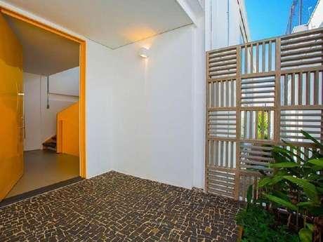 14. O cobogó de concreto é o mais utilizado em áreas externas – Foto: Yta Arquitetura
